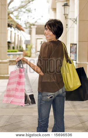 Happy woman shopping at an outdoor mall