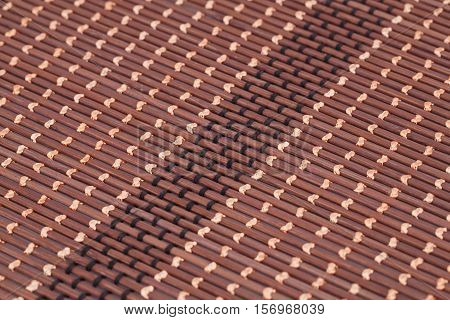 Wooden placemat texture for background close-up image.