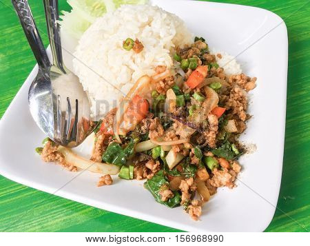 Thai food stir-fried pork and basil served with rice