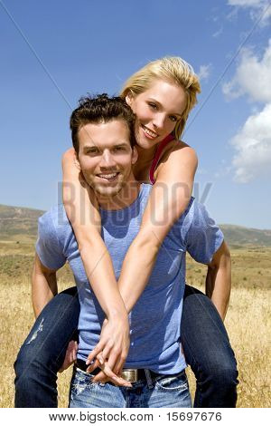 Attractive young couple playing outside