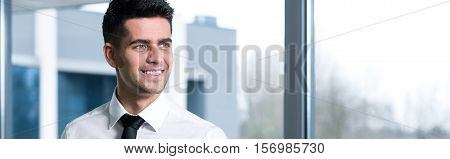 Smiling Businessman In White Shirt