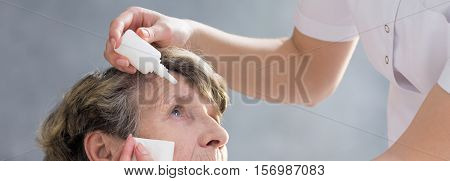 Nurse Putting Eye Drops