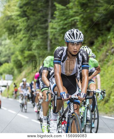 Col du Tourmalet France - July 242014: The Chinese cyclist Ji Cheng of Team Giant-Shimano climbing the road to Col de Tourmalet in the stage 18 of Le Tour de France 2014.
