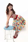foto of peep-toes  - Sexy pinup girl wearing bra and polka dot skirt  - JPG
