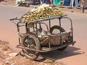 Small Rural Car With Two Wheels Parked In The Street To Sell Sugar Cane, Cameroon, Africa poster
