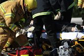 foto of accident victim  - Emergency crew removing a victim from a car accident - JPG