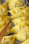 pic of wanton  - Chinese dumplings wrapped in dumpling skin ready to be cooked - JPG