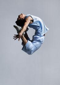 image of ballet dancer  - stylish modern ballet dancer jumping on grey - JPG