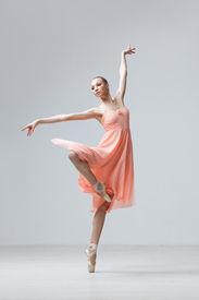 picture of ballet dancer  - modern style dancer posing on studio background - JPG