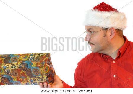 Picture or Photo of Santa presenting a present