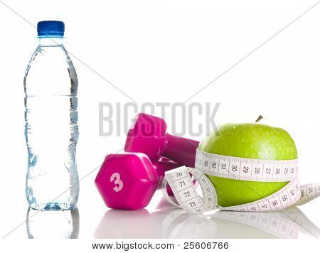 dumbbells, fresh green apple, measure tape and bottle of fresh water