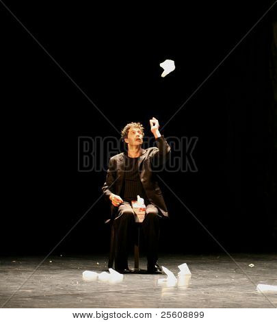 male dancer playing with handkerchief during pina bausch performance
