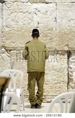 israeli soldier praying at the wailing western wall, jerusalem, israel