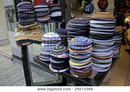 pile of kippas on display in store front, jerusalem