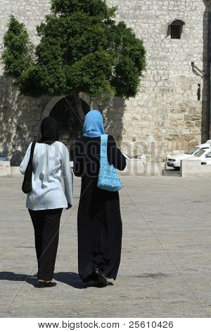 muslim ladies walking in street, bethlehem, west bank, palestine, israel