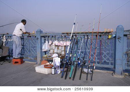 fisherman on bosphorus, istanbul, turkey
