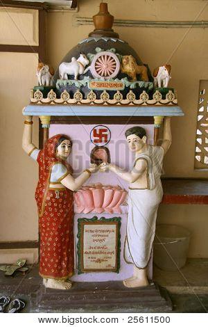 statue of couple inside jain temple, kerala, india