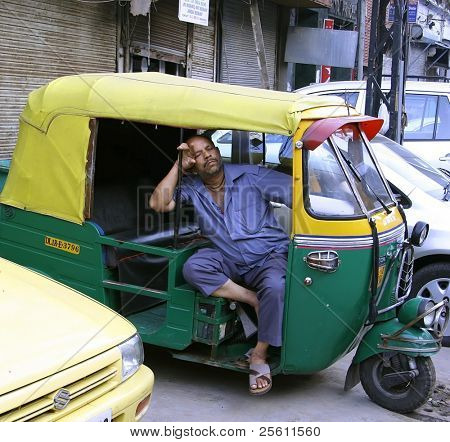 rickshaw driver having siesta, new delhi, india