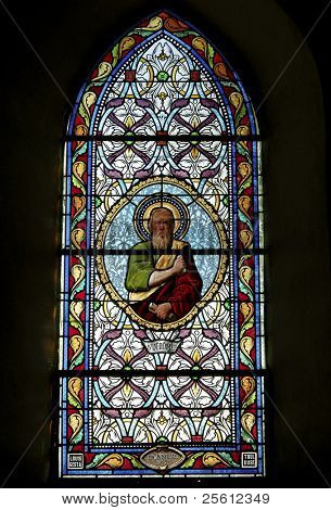 Stain glass window in little church in Correze in France