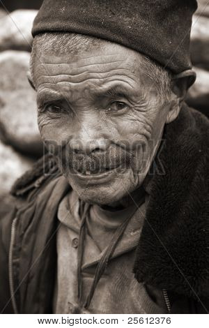 ANNAPURNA, NEPAL - MARCH 20: An unidentified 79-year-old man poses for a portrait in a village on March 20, 2008 in Nepal.