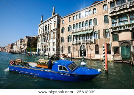 VENICE - OCTOBER 26: Boat transporting coffin and flowers in on October 26, 2009 in Venice, Italy. Boats are the only means of transport, even for the deceased.