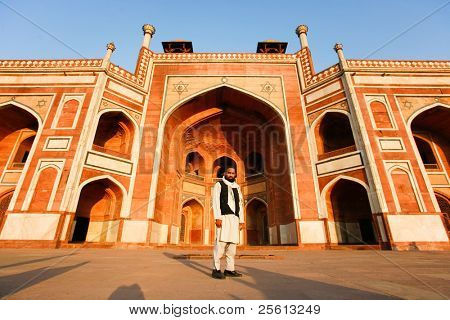 DELHI - FEBRUARY 11: Muslim man in front of Humayun Tomb on February 11, 2008 in Delhi, India. Declared a UNESCO World Heritage Site in 1993.