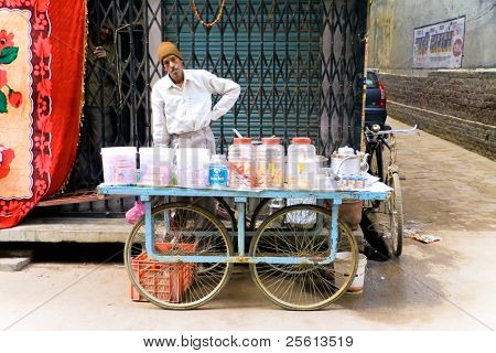 DELHI - DECEMBER 2: Mobile tea stall merchant selling sweets, biscuits and drinks on December 2, 2007 in Delhi, India. It is local tradition to drink tea from the street.