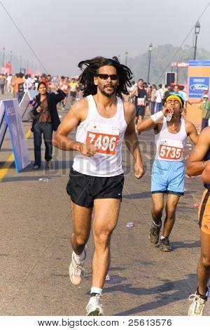 DELHI - OCTOBER 28: Man running during crowded Delhi Half Marathon on October 28, 2007 in Delhi, India. The 2009 event attracted around 29,000 runners.