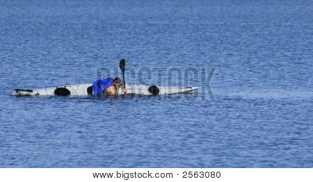 Kayaker Emerges During A Float-Assisted Roll