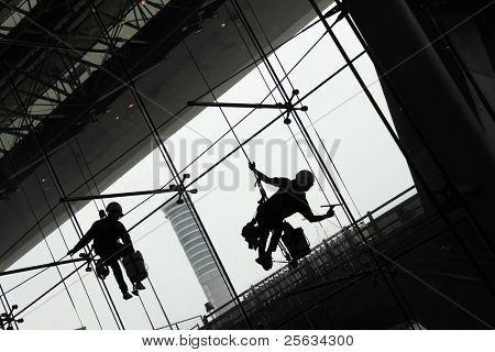 silhouette  of Window Cleaners (Window washers) working