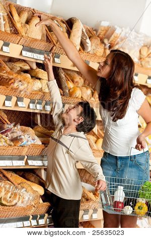 Grocery store -  Woman with child choosing bread
