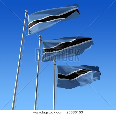 Three flags of Botswana against blue sky.