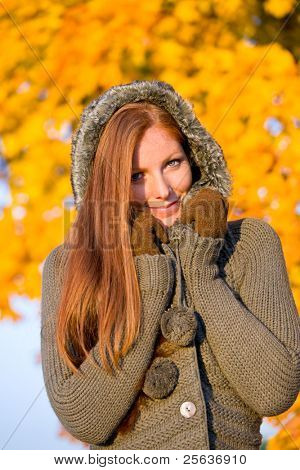 Autumn sunset park - red hair woman fashion in nature