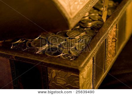 A close up of wooden box filled with UAE Dirham coins