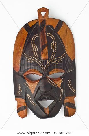 A wooden, african mask on white background