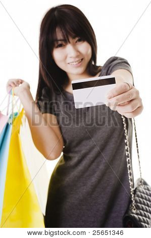 Beautiful Chinese woman holding up a credit card.