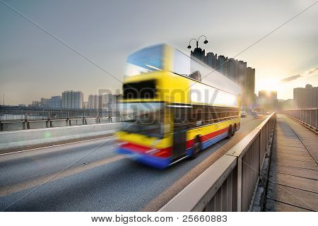 Speed Bus Through Sunset Road