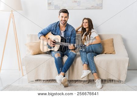 Young Man Playing On Acoustic