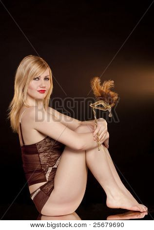 beautiful girl with a gold mask on a black background