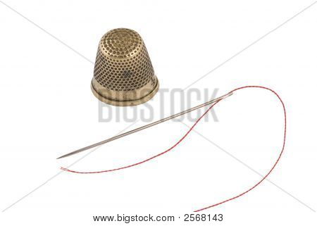 Old Brass Thimble With Needle And Thread