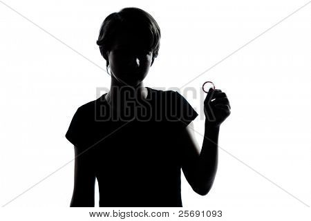 one caucasian young teenager silhouette boy or girl holding condom  portrait in studio cut out isolated on white background