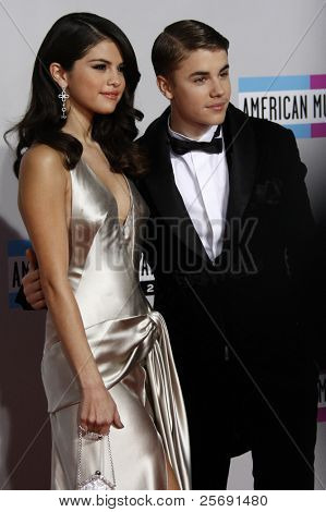 LOS ANGELES - NOV 20: Justin Bieber; Selena Gomez at the 2011 American Music Awards held at Nokia Theatre L.A. Live on November 20, 2011 in Los Angeles, California