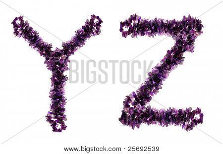 Alphabet from Purple amethyst crystals