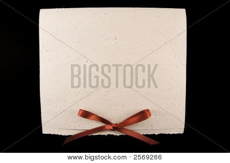 White Diploma With Red Ribbon