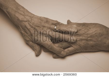 Touching Of Old Hands By Old Man And Old Woman