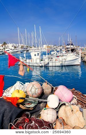 fisher boats with nets long lines buoy tackle in foreground at Formentera