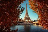Seine in Paris with Eiffel tower in autumn time poster