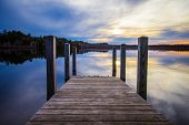 Summer Sunset Over Lake.. Sunset Reflected In The Blue Water Of Brevort Lake With Wooden Dock In The poster