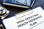 High-deductible Health Insurance Plan Hdhp On A Desk. poster