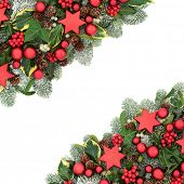 Christmas background border with red bauble decorations, winter flora of holly berries, snow covered poster